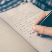 First-Time Home buyer checklist - person writing on a notebook
